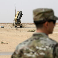A member of the US Air Force stands near a Patriot missile battery at the Prince Sultan air base in al-Kharj, central Saudi Arabia, February 20, 2020. (Andrew Caballero-Reynolds/Pool via AP)