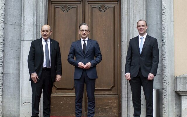 File: German Foreign Minister Heiko Maas, center, welcomes the Foreign Minister of Great Britain, Dominic Raab, right, and the Foreign Minister of France, Jean-Yves Le Drian, left, for a meeting in Berlin, Germany, Friday, June 19, 2020. (Bernd von Jutrczenka/DPA via AP, Pool)