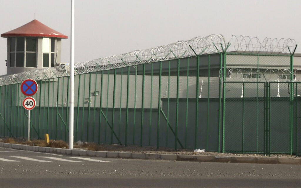 In this Dec. 3, 2018, photo, a guard tower and barbed wire fence surround a detention facility in the Kunshan Industrial Park in Artux in western China's Xinjiang region. (AP Photo/Ng Han Guan)