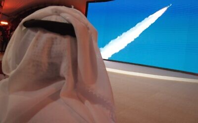 An Emirati man watches the launch of the 'Amal' (Hope) space probe at the Mohammed bin Rashid Space Center in Dubai, United Arab Emirates, Monday, July 20, 2020 (AP Photo/Jon Gambrell)
