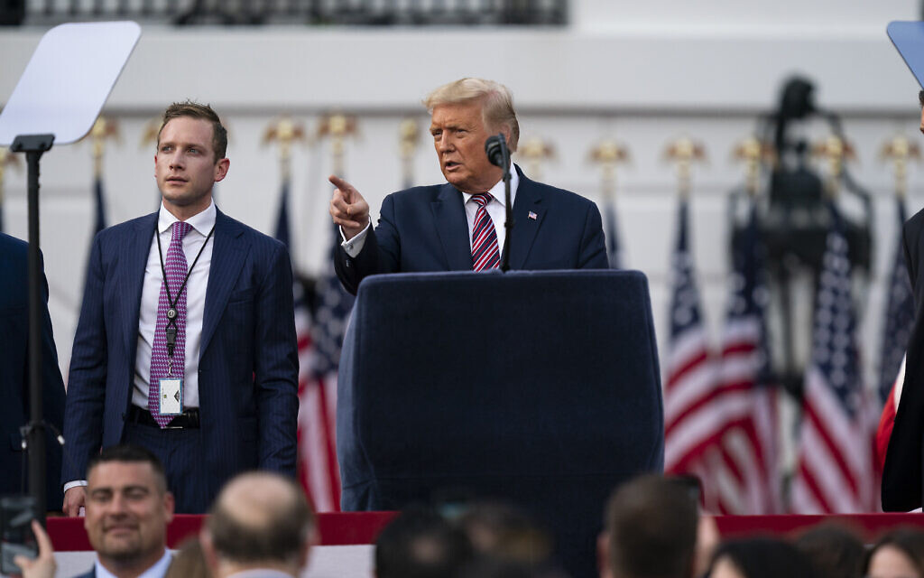US President Donald Trump talks with Deputy Campaign Manager for Presidential Operations Max Miller, left, before his speech to the Republican National Convention on the South Lawn of the White House, Aug. 27, 2020, in Washington. (AP Photo/Evan Vucci)