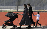 Illustrative: In this October 4, 2020, photo, two women walk with children during the Jewish holiday of Sukkot in the Borough Park neighborhood of the Brooklyn borough of New York. (AP/Kathy Willens)