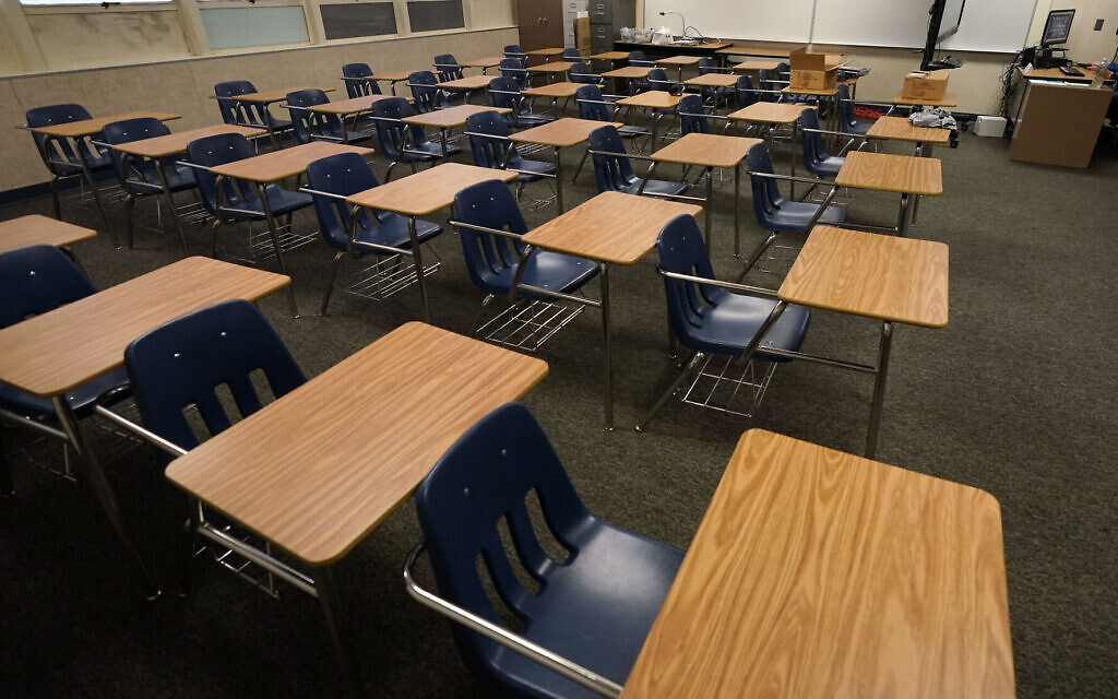 Illustrative -- Empty desks at a junior high school in California, Oct. 6, 2020 (AP Photo/Gregory Bull, File)