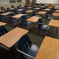 Illustrative: Empty desks at a junior high school in California, October 6, 2020 (AP Photo/Gregory Bull, File)