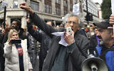The brother of former Labour leader Jeremy Corbyn, Piers Corbyn, gestures during a coronavirus anti-lockdown rally on Oxford Street, in London, Saturday, Oct. 17, 2020. (Dominic Lipinski/PA via AP)