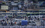 Illustrative: Passengers queue to get on buses in the capital Addis Ababa, Ethiopia, Nov. 6, 2020. (AP/Mulugeta Ayene)