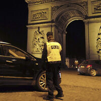 Illustrative -- A French police officer next to the Arc de Triomphe in Paris, France, Dec. 15, 2020 (AP Photo/Francois Mori)