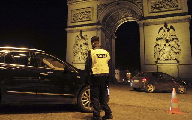 Illustrative -- A French police officer next to the Arc de Triomphe in Paris, France, Dec. 15, 2020 (AP Photo/Francois Mori)