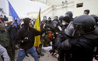 Trump supporters try to break through a police barrier, Jan. 6, 2021, at the Capitol in Washington (AP Photo/Julio Cortez)