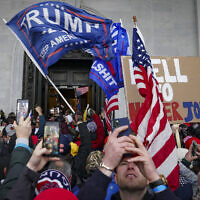 In this January 6, 2021, photo, Trump supporters gather outside the Capitol in Washington. (AP Photo/John Minchillo)