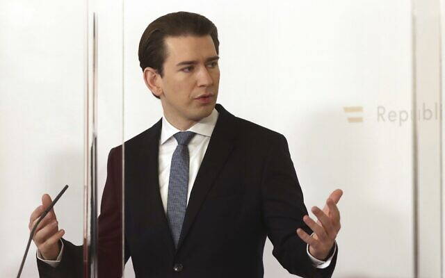 Austrian Chancellor Sebastian Kurz speaks behind plexiglass shields at a press conference at the federal chancellery in Vienna, Austria, Sunday, Jan. 17, 2021 (AP Photo/Ronald Zak)