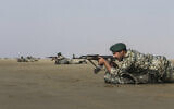 In this photo released Jan. 20, 2021, by the Iranian Army, troops participate in a military drill (Iranian Army via AP)