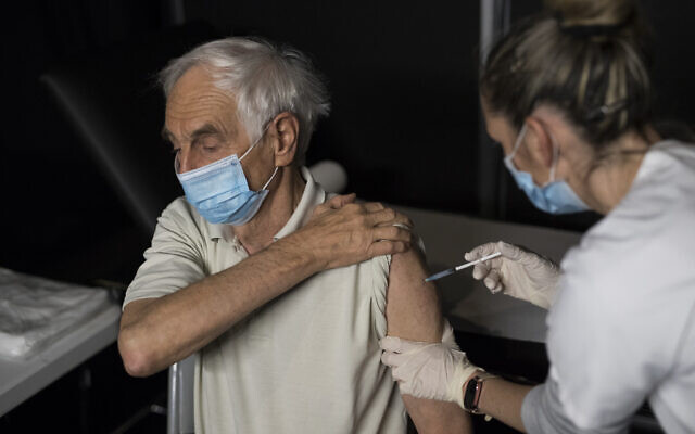 Nurse Coralie Ferron administers a dose of the Moderna COVID-19 vaccine at a vaccination center in Le Cannet, southern France, January 21, 2021. (AP Photo/Daniel Cole)