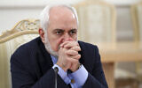Iranian Foreign Minister Mohammad Javad Zarif listens during the talks in Moscow, Russia, January 26, 2021. (Russian Foreign Ministry Press Service via AP)