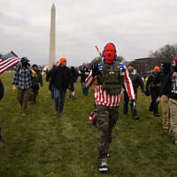 In this January 6, 2021 photo, people march with those who say they are members of the Proud Boys as they attend a rally in Washington, DC in support of then-US president Donald Trump. (AP Photo/Carolyn Kaster)