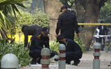 National Security Guard soldiers inspect the site of a blast near the Israeli Embassy in New Delhi, India, on January 30, 2021. (Dinesh Joshi/AP)