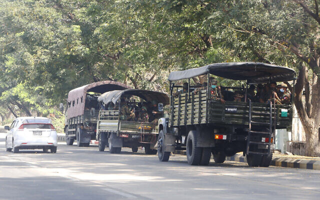 Soldiers sit inside trucks parked on a road in Naypyitaw, Myanmar, February 1, 2021. (AP Photo)