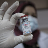Illustrative: A Palestinian medic displays a vial of the Moderna COVID-19 vaccine in the West Bank city of Bethlehem, February 3, 2021, as the Palestinian Authority began administering coronavirus vaccinations after receiving several thousands of doses of the Moderna vaccine from Israel. (AP Photo/Nasser Nasser)