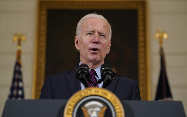 US President Joe Biden speaks about the economy in the State Dining Room of the White House, Feb. 5, 2021, in Washington. (AP Photo/Alex Brandon)