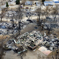 In this November 18, 2020, photo taken by a drone, residences destroyed by the Mountain View Fire line a street in the Walker community in Mono County, California.(AP/Noah Berger)