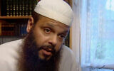 In this image from video made in 2005, Abdul Benbrika, an Algerian-born Muslim cleric, speaks during an interview at his home in Melbourne, Australia. (Australian Broadcasting Corporation via AP)