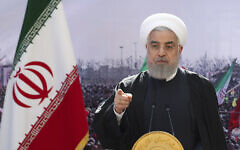 In this photo released by the official website of the office of the Iranian Presidency, President Hassan Rouhani addresses the nation in a televised speech in Tehran, Iran, February 10, 2021. (Iranian Presidency Office via AP)