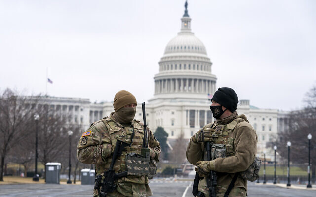 Members of the National Guard patrol the area outside of the US Capitol on the third day of the second impeachment trial of former President Donald Trump, on Capitol Hill in Washington, February 11, 2021. (AP Photo/Jose Luis Magana)