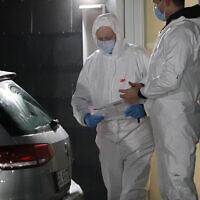 Danish forensic technicians work at Apotekerhaven in Holbaek, Denmark, on February 6, 2021, as Danish police search addresses in Apotekerhaven. (presse-fotos.dk/Ritzau via AP)