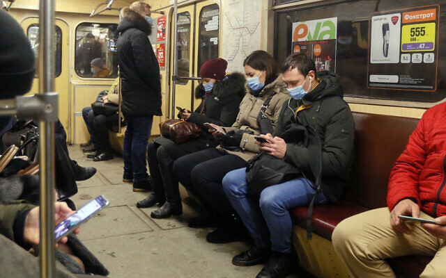 People wearing face masks to prevent the spread of the coronavirus ride in a subway train in Kyiv, Ukraine on Feb. 12, 2021. (AP Photo/Efrem Lukatsky)
