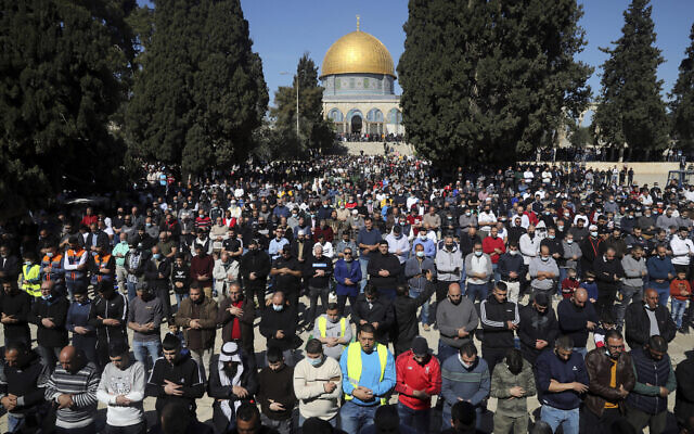 Muslim worshipers take part in Friday prayers at the Dome of the Rock Mosque in the Al Aqsa Mosque complex in the Old City of Jerusalem, February 12, 2021. (AP Photo/Mahmoud Illean)