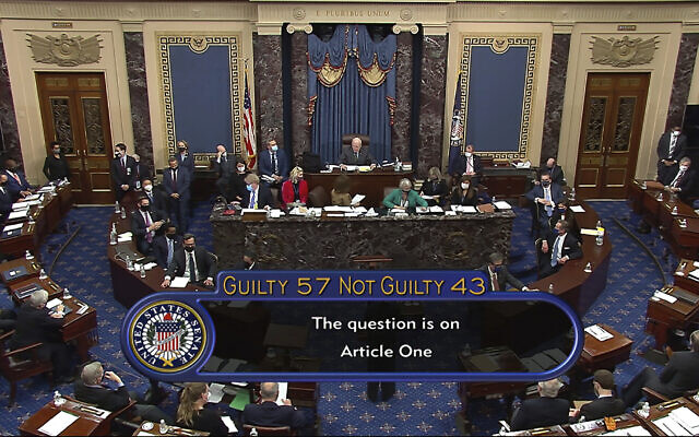 In this image from video, the final vote total of 57-43, to acquit former US President Donald Trump of the impeachment charge, incitement of insurrection, in the Senate at the US Capitol in Washington, February 13, 2021. (Senate Television via AP)