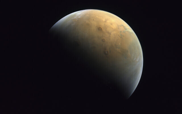 This Feb. 10, 2021 image taken by the United Arab Emirates' 'Amal,' or 'Hope,' probe and released February 14, 2021, shows Mars (Mohammed bin Rashid Space Center/UAE Space Agency, via AP)