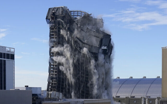 "The former Trump Plaza casino is imploded on Wednesday, Feb. 17, 2021, in Atlantic City, N.J. After falling into disrepair, the one-time jewel of former President Donald Trump's casino empire is reduced to rubble, clearing the way for a prime development opportunity on the middle of the Boardwalk, where the Plaza used to market itself as ""the center of it all."" (AP Photo/Seth Wenig)"