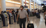 In this screengrab, Senator Ted Cruz, walks to check in for his flight back to the US, at Cancun International Airport in Cancun, Mexico, Febuary 18, 2021. (AP/Dan Christian Rojas)