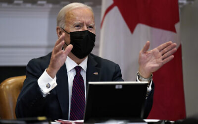 US President Joe Biden holds a virtual bilateral meeting with Canadian Prime Minister Justin Trudeau, in the Roosevelt Room of the White House, Tuesday, Feb. 23, 2021, in Washington. (AP Photo/Evan Vucci)
