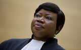 Prosecutor Fatou Bensouda waits for former Congo vice president Jean-Pierre Bemba to enter the court room of the International Criminal Court to stand trial with Aime Kilolo Musamba, Jean-Jacques Mangenda Kabongo, Fidele Babala Wandu and Narcisse Arido, on charges including corruptly influencing witnesses by giving them money and instructions to provide false testimony, and presenting false evidence, in The Hague, Netherlands, September 29, 2015. (AP/Peter Dejong/File)