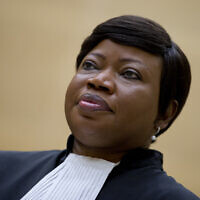 Prosecutor Fatou Bensouda waits for former Congo vice president Jean-Pierre Bemba to enter the court room of the International Criminal Court to stand trial with Aime Kilolo Musamba, Jean-Jacques Mangenda Kabongo, Fidele Babala Wandu and Narcisse Arido, on charges including corruptly influencing witnesses by giving them money and instructions to provide false testimony, and presenting false evidence, in The Hague, Netherlands, September 29, 2015. (AP/Peter Dejong)