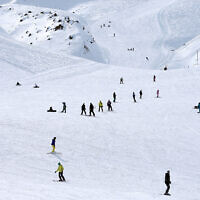 In this Jan. 15, 2016 photo, Iranian skiers descend from a slope at Dizin ski resort some 72 kilometers (45 miles) north of the capital Tehran, Iran (AP Photo/Ebrahim Noroozi)