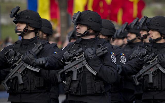 Illustrative: Anti-terrorist units of the Romanian Informations Service (SRI) march during national day celebrations in Bucharest, Romania, Dec. 1, 2015. (AP Photo/Vadim Ghirda)