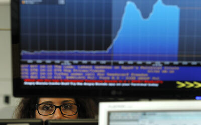 Illustrative: A broker works in a trading room of a Portuguese bank in Lisbon, Wednesday, July 3, 2013. (AP/Francisco Seco)