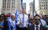 New York City Mayor Bill de Blasio, center, marches up Fifth avenue during the Celebrate Israel Parade, June 1, 2014, in New York. (AP Photo/John Minchillo)