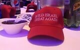 """Each table at Young Israel's gala dinner in 2019 was decorated by MAGA-style hats reading """"Build Israel great again."""" (Ben Sales/JTA)"""