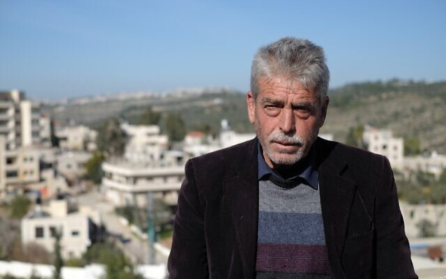 The father of Khaled Nofal, who was killed in an altercation with Israeli settlers, on top of the family home in the West Bank village of Ras Karkar on February 11, 2021. (Judah Ari Gross/Times of Israel)