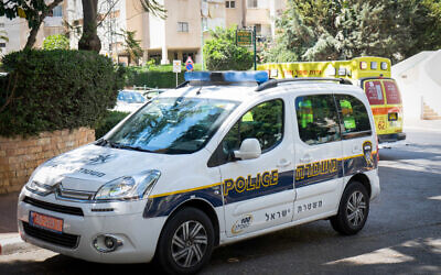 Illustrative: An Israel Police car in Petah Tikva, August 4, 2017 (Roy Alima/Flash90)