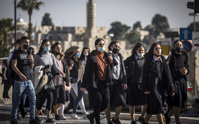 Israelis walk in Jerusalem on February 15, 2021. (Olivier Fitoussi/Flash90)