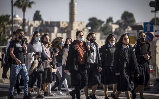 Israelis walk in Jerusalem on February 15, 2021. (Olivier Fitoussi/Flash90)