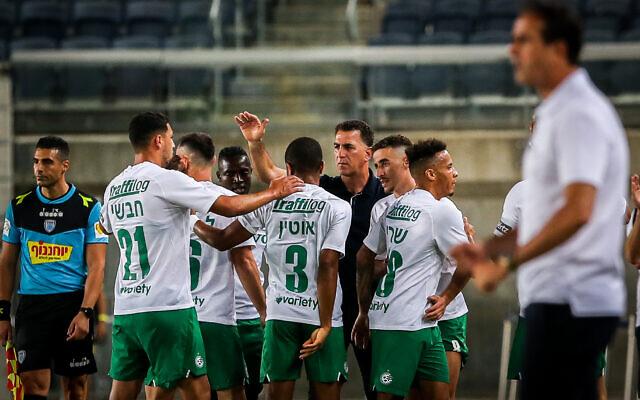 Maccabi Haifa players celebrate a goal during an Israeli Premier League match between Beitar Jerusalem and Maccabi Haifa at the Teddy Stadium in Jerusalem on July 7, 2020. (Flash90)