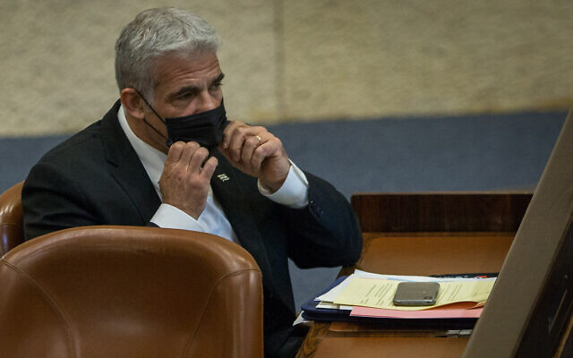 MK Yair Lapid attends a Knesset plenary session at the Knesset in Jerusalem on August 24, 2020 (Oren Ben Hakoon/POOL)