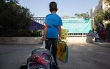 A first-grade student on his first day of school at Tali Geulim school in Jerusalem, on September 1, 2020. (Noam Revkin Fenton/Flash90)