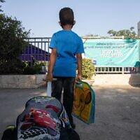 First grade students on their first day of school at Tali Geulim school in Jerusalem on September 1, 2020. (Noam Revkin Fenton/Flash90)